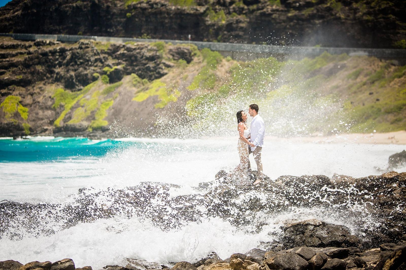 Oahu Engagement Photographer Couple Photo Shoot Water Wave Splash Lava Rocks Makapuu Beach Hawaii